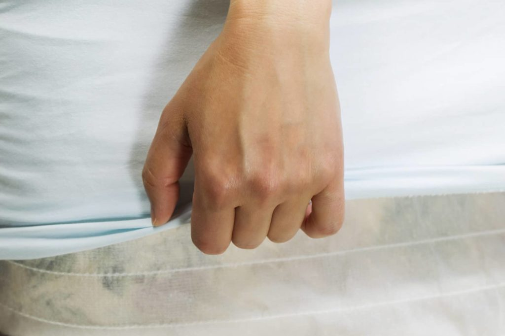 Hand pulling bed sheet