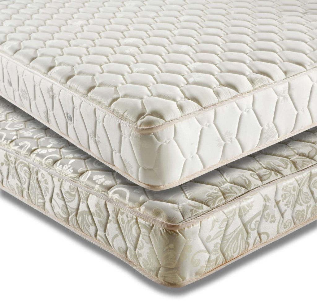 traditional mattress on top of another