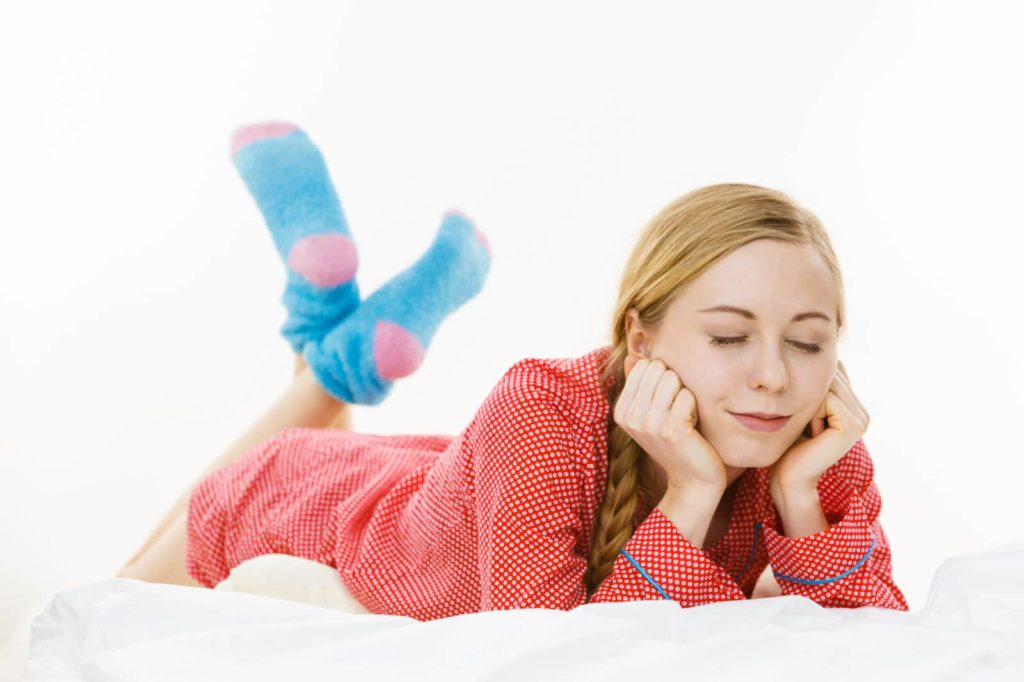 woman with socks for sleeping