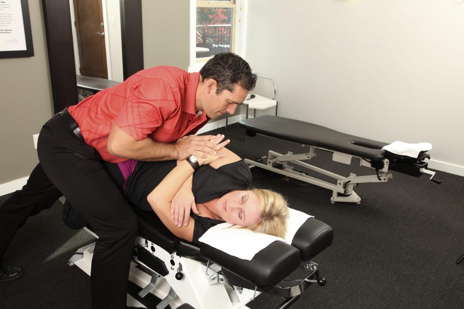 a chiropractor does adjustments on a woman