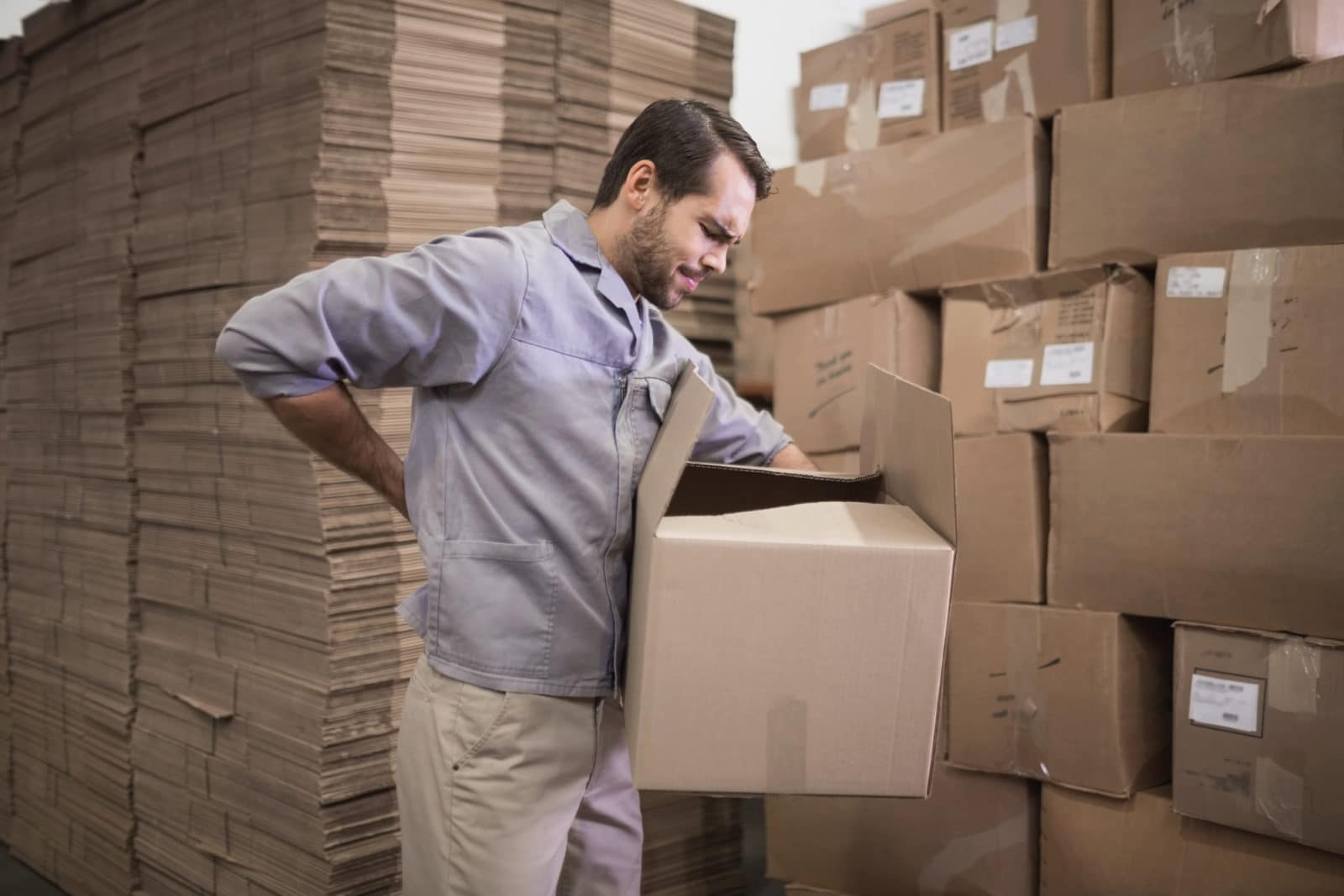 a worker who frequently carries heavy boxes is experiencing back pain