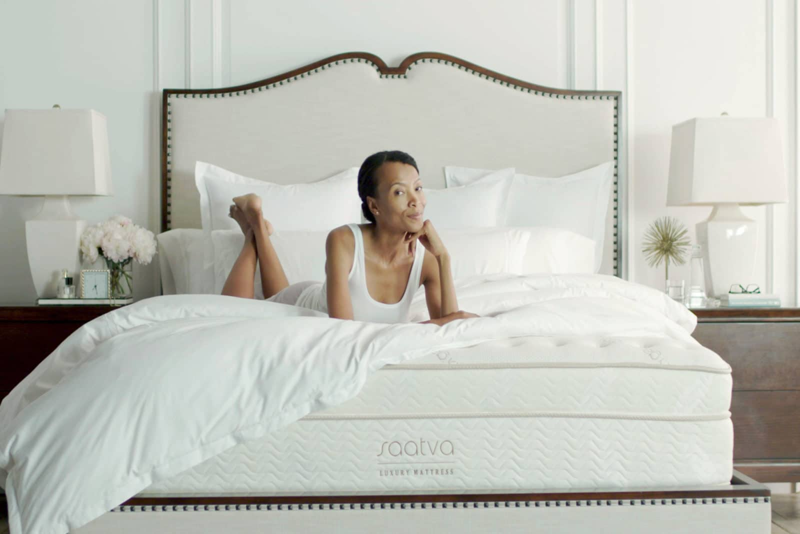 woman is happy with her Saatva bed