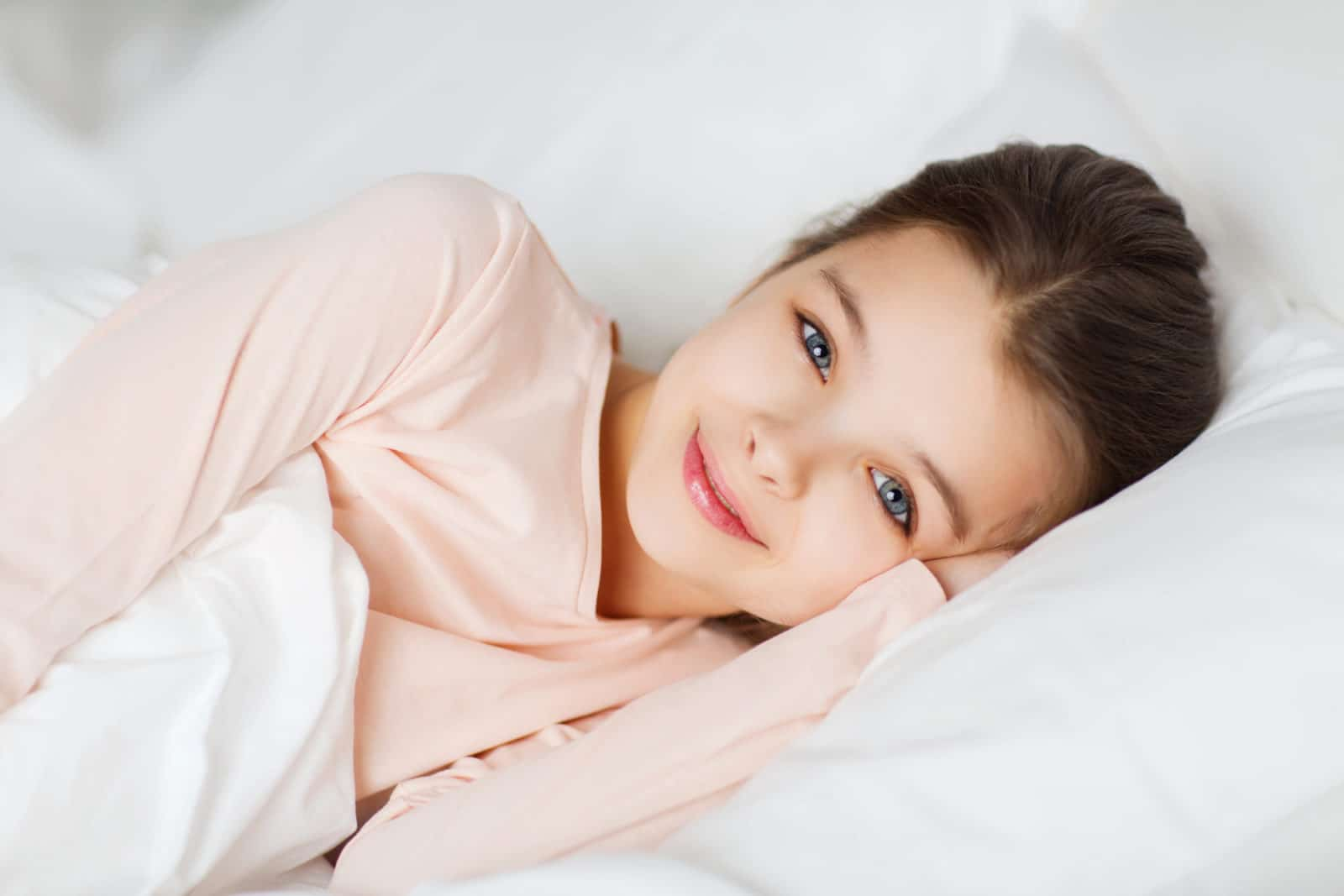 cute girl with her head on a pillow