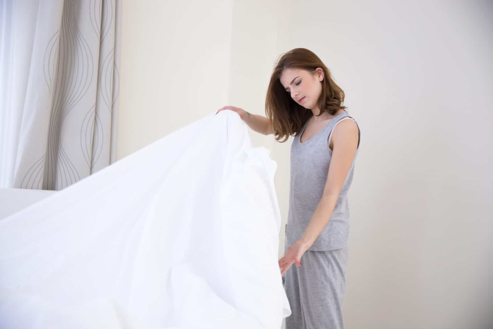 young woman looking at her sheets