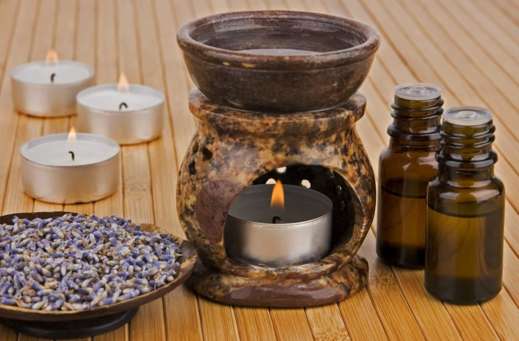 aromatherapy lamp with oil and dried lavender