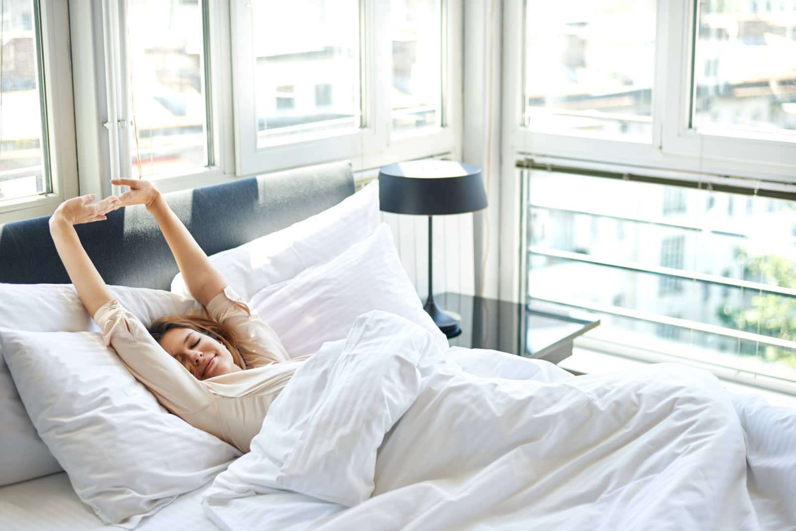 a woman stretching on the bed
