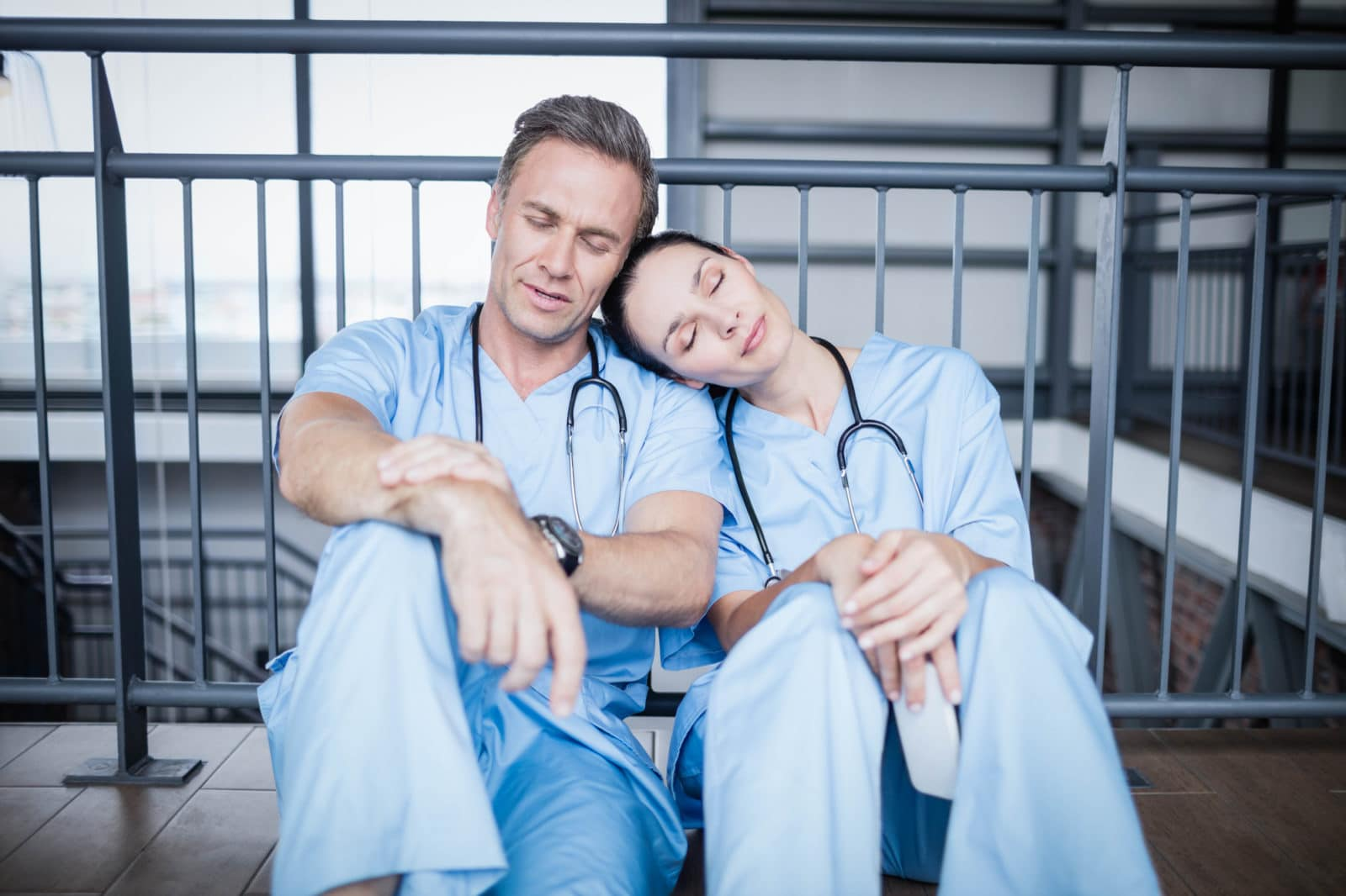 hospital staff napping on the floor