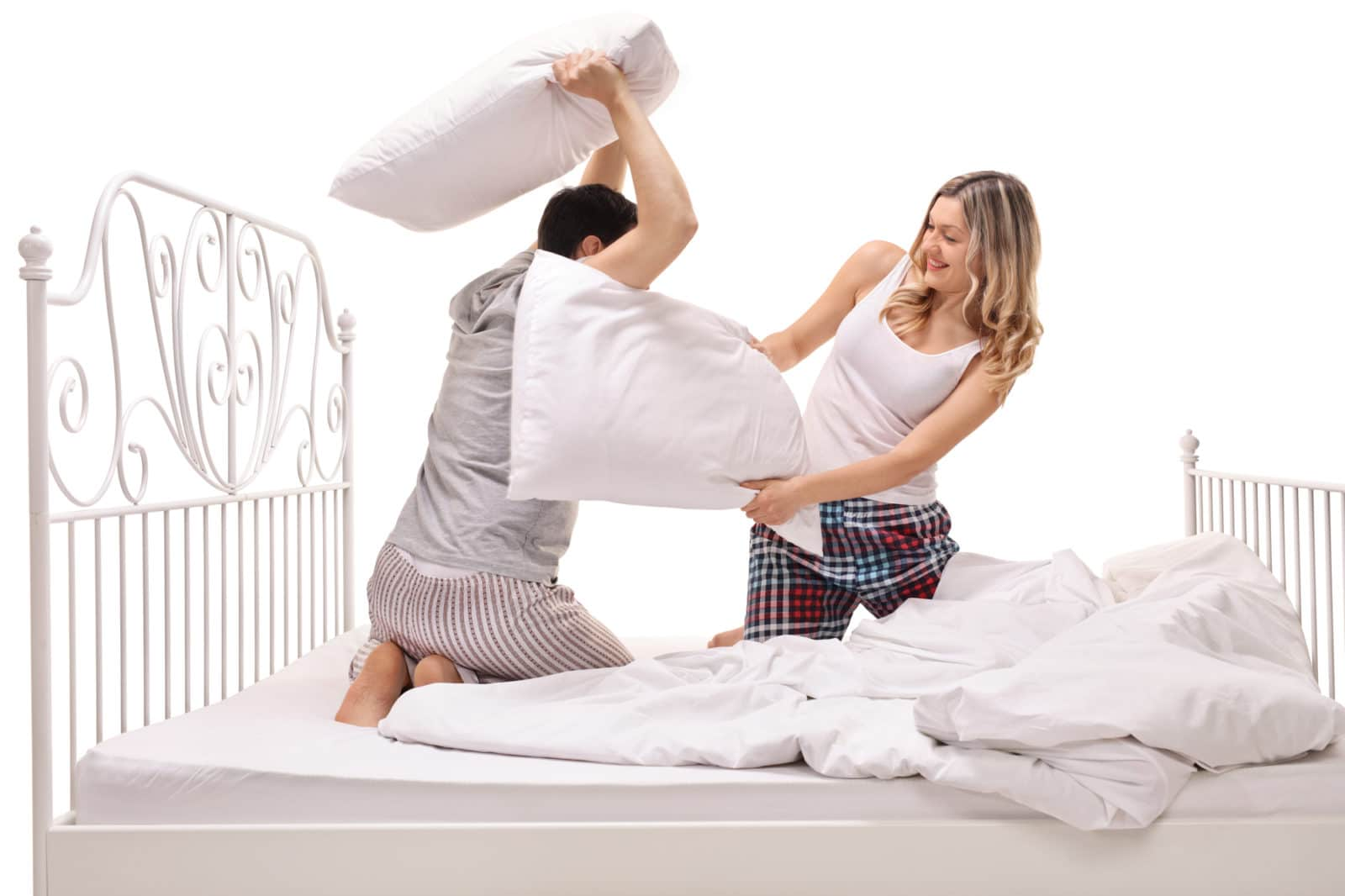 pillow fighting couple