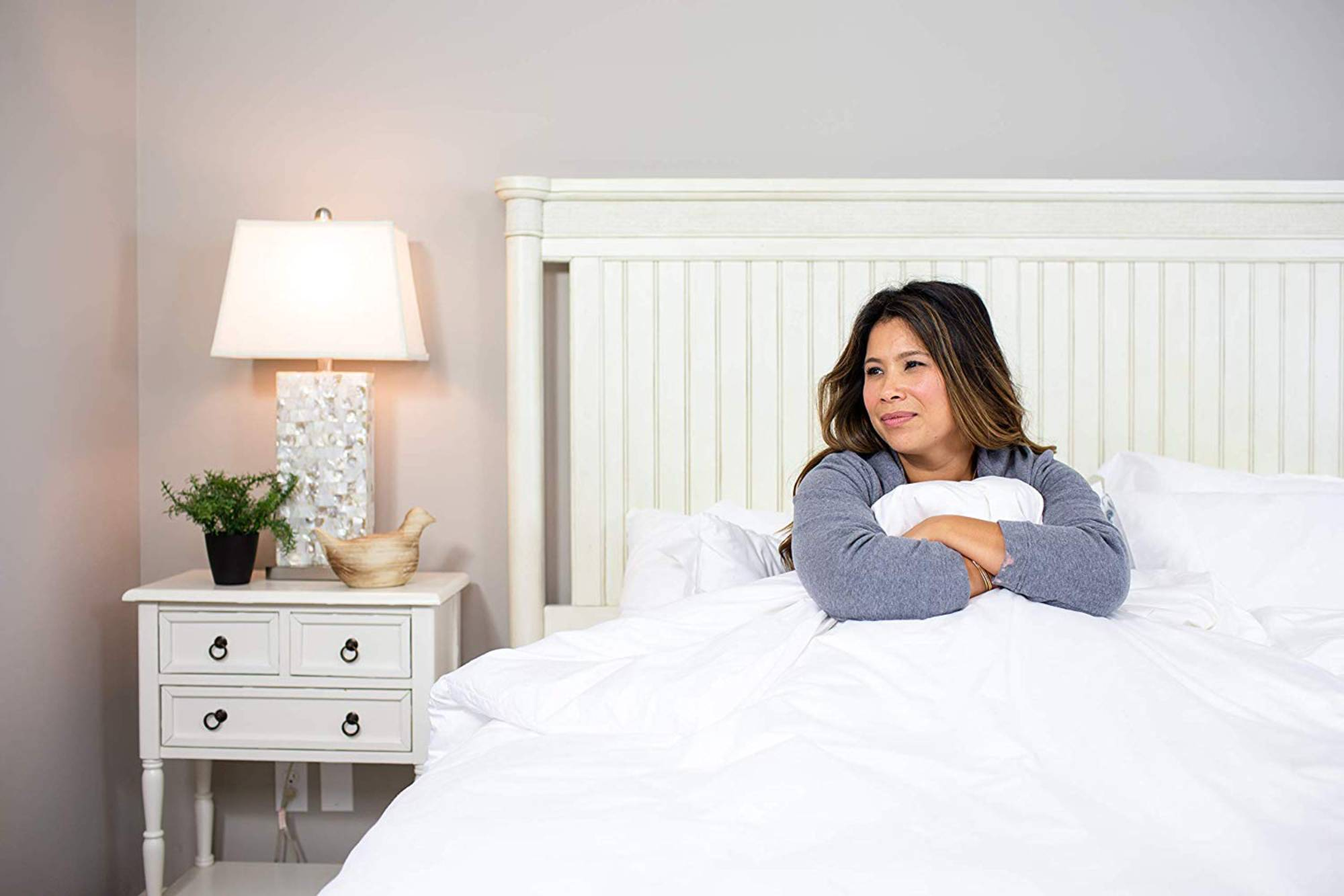 a woman hugging a percale sheet