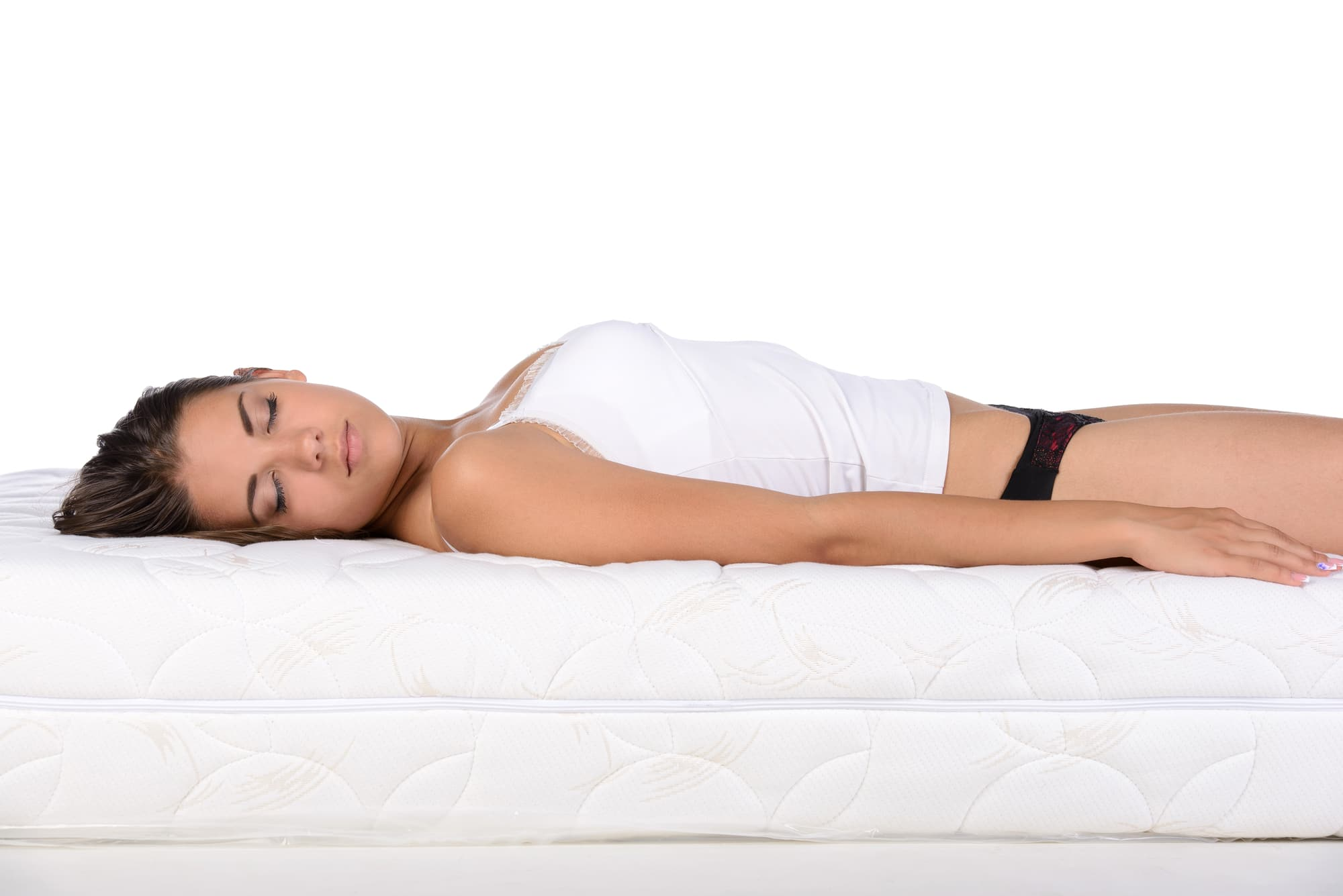 a woman lying flat on the bed