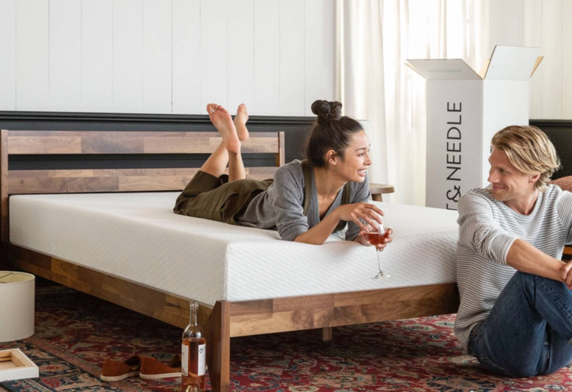a couple drinking in the bed