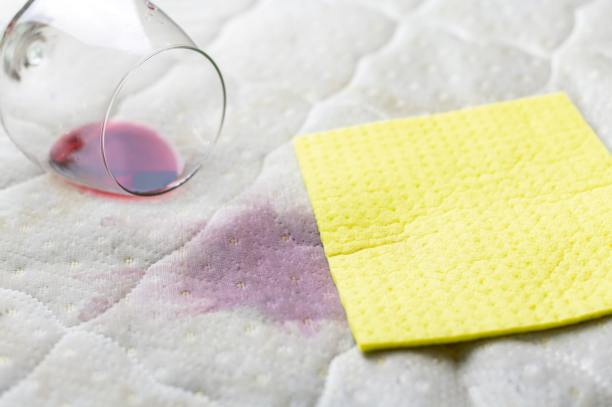 wine stain and sponge on a mattress