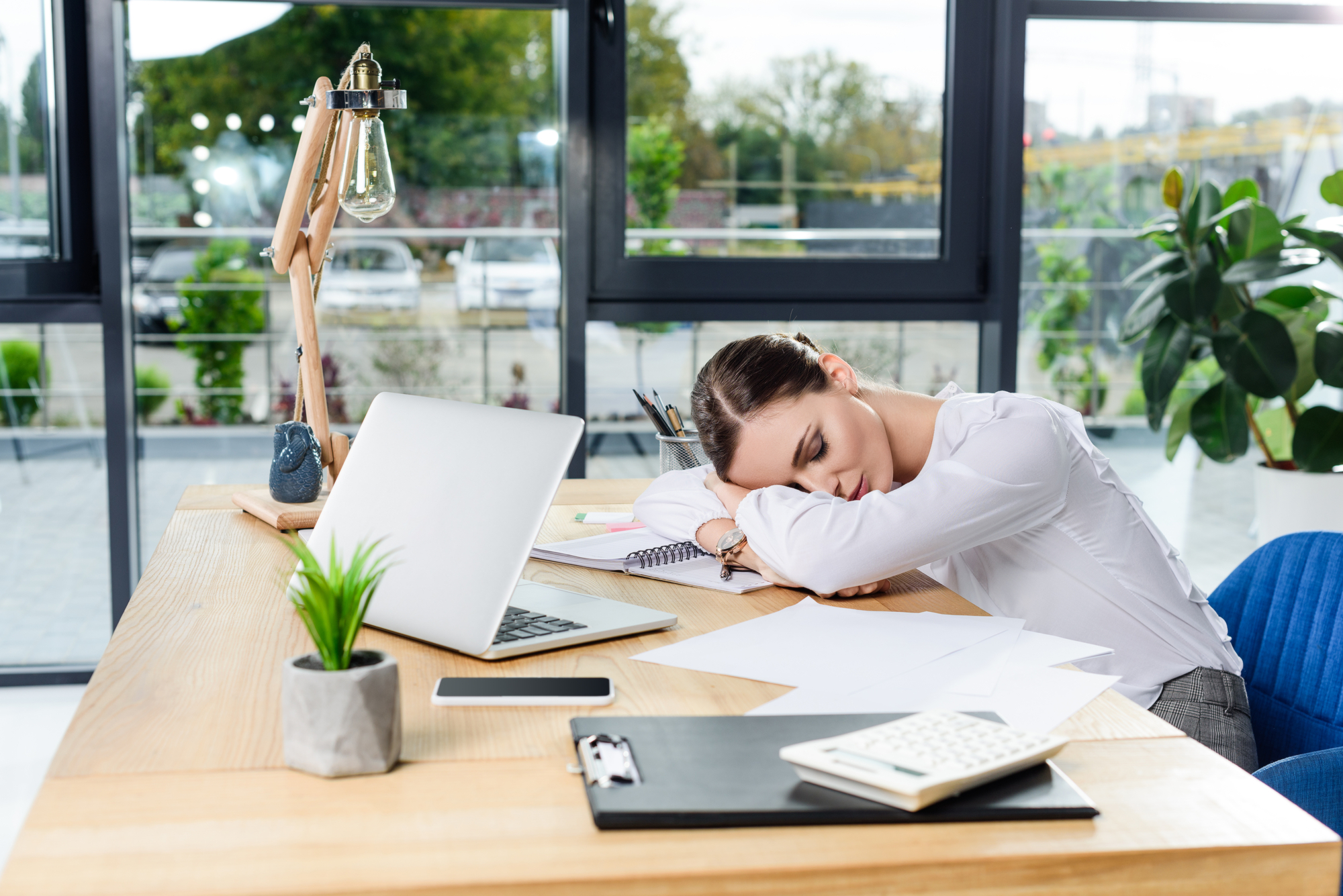 woman taking a nap at office