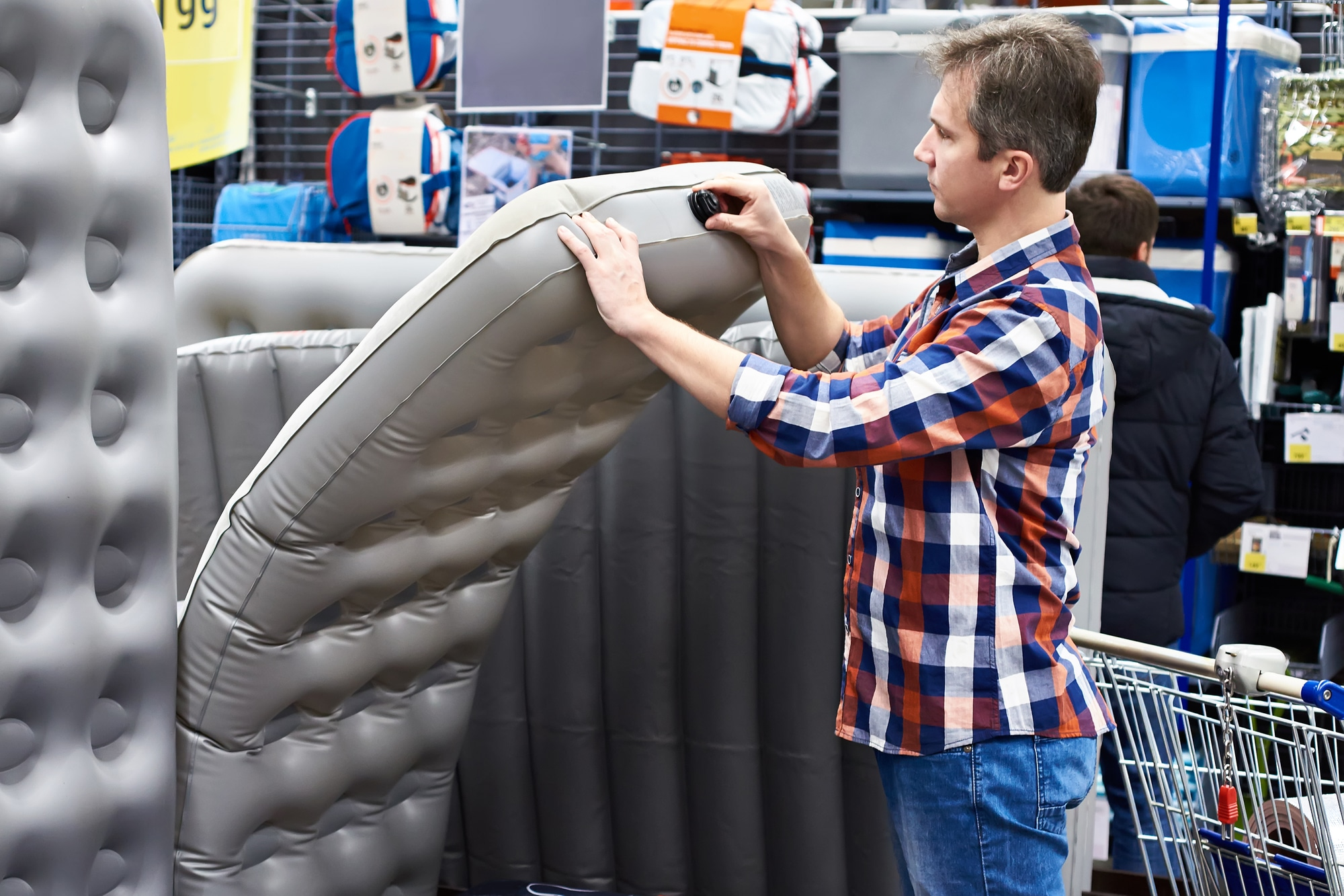 a man shopping for a blow-up bed