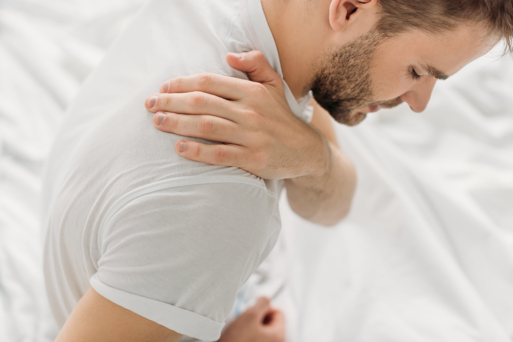 man suffering from soreness and stiffness